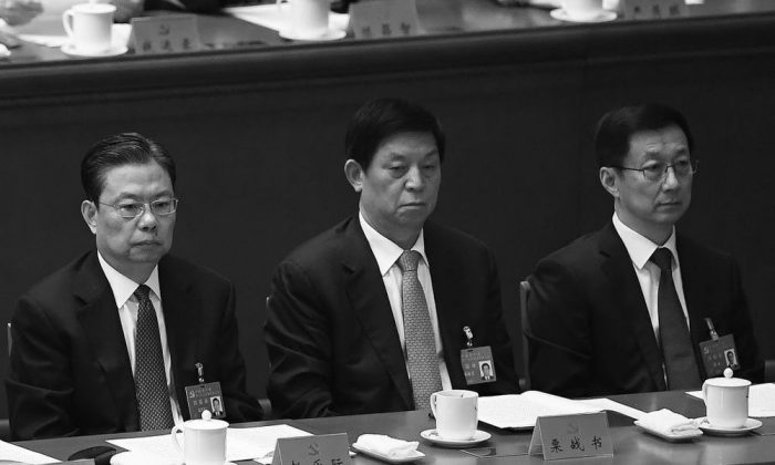 Han Zheng (R) talks to Li Zhanshu (C) and Zhao Leji (L) at the closing session of the 19th National Congress on Oct. 24, 2017. All three are newly appointed to the Chinese Communist Party's top decision-making body, the Politburo Standing Committee. (Wang Zhao/AFP/Getty Images)