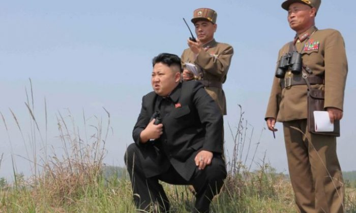 North Korean leader Kim Jong Un (C) guides the multiple-rocket launching drill in this undated photo released by North Korea's Korean Central News Agency (KCNA) April 24, 2014. (KCNA via REUTERS/File Photo)