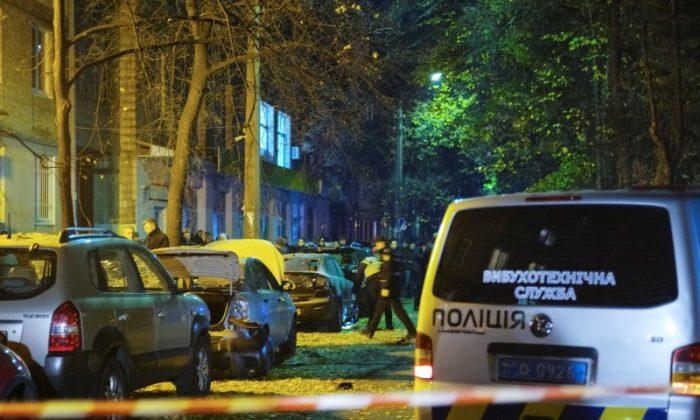 Investigators work at the site of a car explosion in central Kiev, Ukraine Oct.0 25, 2017. (REUTERS/Gleb Garanich)