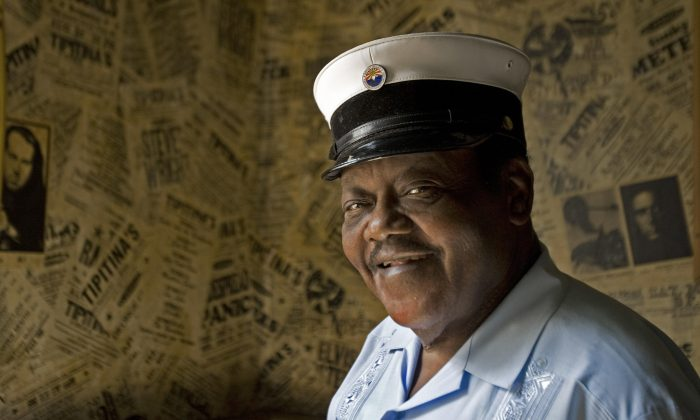 """New Orleans resident and legendary pianoman Fats Domino pauses a moments for a photo after meeting with reporters on Aug. 19, 2007 to talk about his new 2- disk album """"Goin' Home: A Tribute to Fats Domino"""" to be released on Sept. 25, 2007. (PAUL J. RICHARDS/AFP/Getty Images)"""