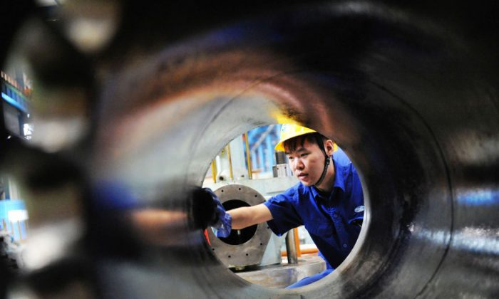 A worker cleaning a diesel engine part in Qingdao, China, Aug. 29, 2017. China's economy has been strong recently but Daniel Lacalle argues there will be a price to pay.  (STR/AFP/Getty Images)