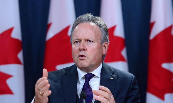 Governor of the Bank of Canada Stephen Poloz holds a press conference in Ottawa on Oct. 25, 2017. The central bank took a more cautious stance and held its overnight rate target at 1 percent. (The Canadian Press/Sean Kilpatrick)