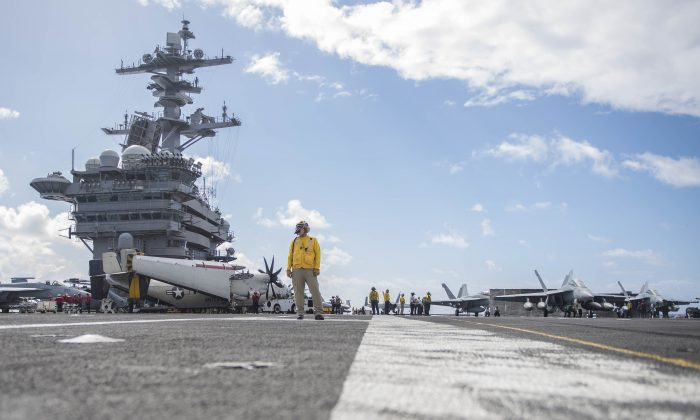 Sailors conduct flight operations on the flight deck of the aircraft carrier USS Theodore Roosevelt (CVN 71). The Theodore Roosevelt is currently underway for a regularly scheduled deployment to the U.S. 7th in support of maritime security operations and theater security cooperation efforts.(Mass Communication Specialist 3rd Class Spencer Roberts)