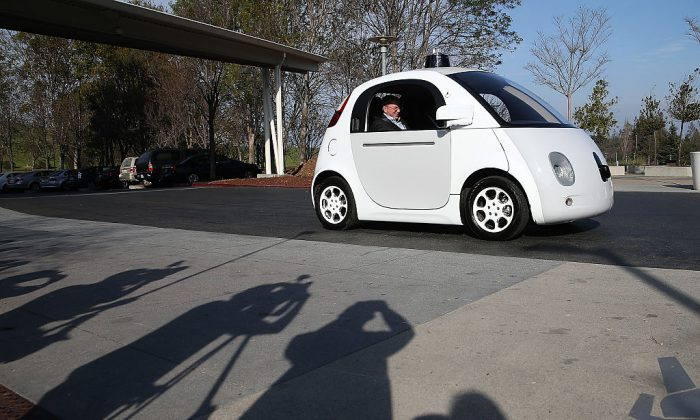 Google Chairman Eric Schmidt sits in a Google self-driving car at the Google headquarters on February 2, 2015 in Mountain View, California.    (Justin Sullivan/Getty Images)