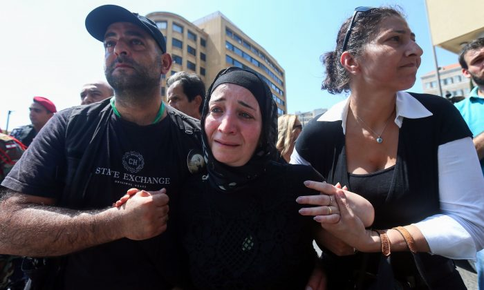 A woman reacts during the repatriation of the bodies of fallen Lebanese army soldiers, who died after they had been taken hostage in 2014 by the ISIS group and whose remains were found along the Syrian border, in the capital Beirut's downtown Riad al-Solh Square on Sept. 8, 2017.