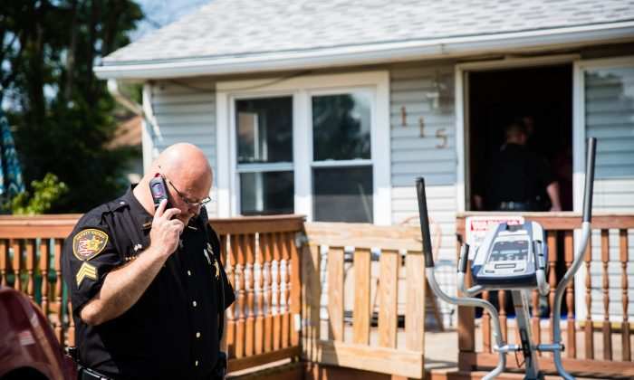 A deputy from the Montgomery County Sheriffâs Office and staff from the Montgomery County Coroner, at the home of a man who was found dead from an apparent drug overdose in the Drexel neighborhood of Montgomery County, Ohio, on Aug. 3, 2017. (Benjamin Chasteen/The Epoch Times)