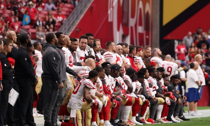 Members of the San Francisco 49ers kneel for the National Anthem before the start of the NFL game against the Arizona Cardinals at the University of Phoenix Stadium on Oct. 1, 2017, in Glendale, Ariz. (Christian Petersen/Getty Images)