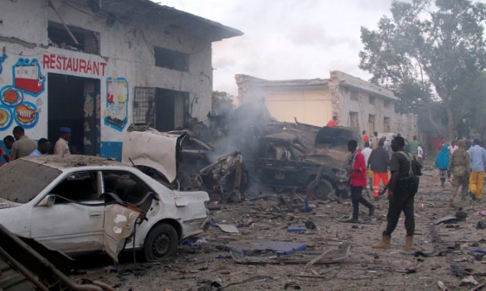 A general view shows the aftermath of a  bomb explosion, at the gate of Naso Hablod Two Hotel in Hamarweyne district of Mogadishu, Somalia October 28, 2017. (Reuters/Feisal Omar)