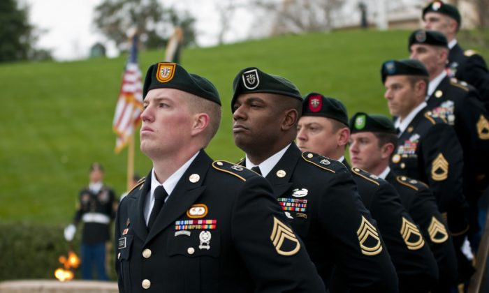 Soldiers from each of the U.S. Army's Special Forces groups stand silent during the wreath-laying ceremony at the grave of President John F. Kennedy at Arlington National Cemetery on Nov. 17, 2011. (U.S. Army)