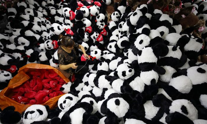 "A Chinese worker makes stuffed panda toys for export at a toy factory in Lianyungang, Jiangsu Province on Oct. 9, 2017. A recent survey placed China at the bottom of a ""Made-in-Country Index."" (STR/AFP/Getty Images)"