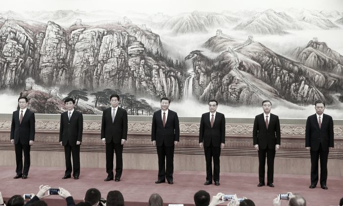 (L to R) Han Zheng, Wang Huning, Li Zhanshu, Xi Jinping, Li Keqiang, Wang Yang, and Zhao Leji,  members of the Chinese Communist Party's Politburo Standing Committee, attends a news conference following the end of the 19th National Congress, at the Great Hall of the People in Beijing on October 25, 2017. (Lintao Zhang/Getty Images)
