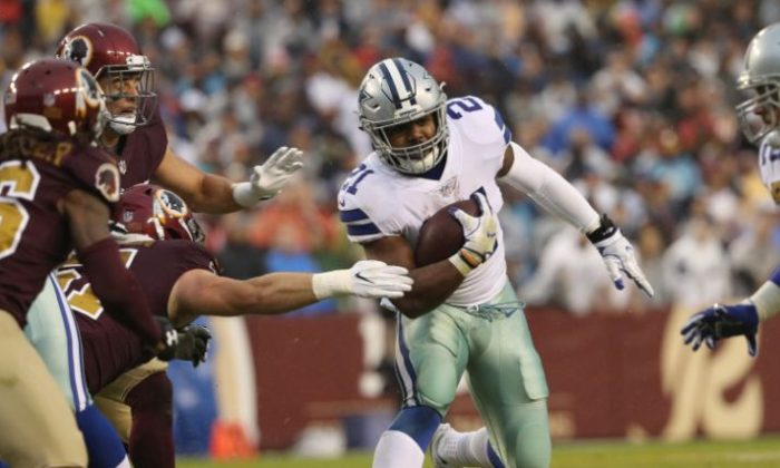 Running back Ezekiel Elliott #21 of the Dallas Cowboys runs upfield against the Washington Redskins during the second quarter at FedEx Field in Landover, Maryland on Oct. 29, 2017. (Photo by Patrick Smith/Getty Images)