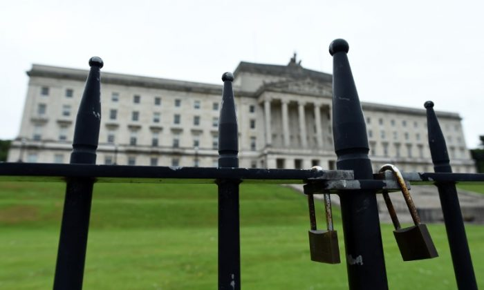 A gate is padlocked in front of Stormont Castle, the seat of devolved government in Belfast, Northern Ireland June 28, 2017. (Reuters/Clodagh Kilcoyne)
