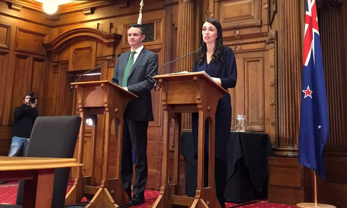 New Zealand's Prime Minister-designate Jacinda Ardern speaks as she stands next to New Zealand Green Party leader James Shaw in Wellington, New Zealand, on Oct. 24, 2017. (REUTERS/Nicolaci da Costa)