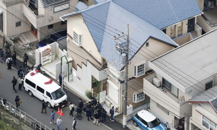 This aerial photo shows the apartment, center, where police found dismembered bodies in coolers in Zama city, southwest of Tokyo, on Tuesday, Oct. 31, 2017. A police spokesman said Tuesday the 27-year-old suspect confessed to cutting up the bodies and hiding them in cold-storage cases, covered with cat litter. (Kyodo News via AP)