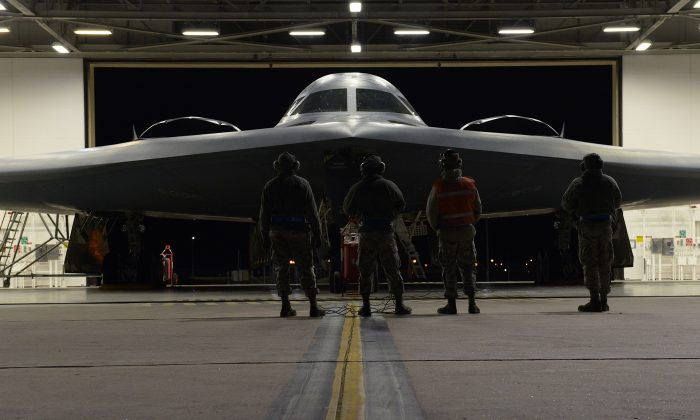 U.S. Air Force maintainers inspect a B-2 Spirit before it takes off from Whiteman Air Force Base, Mo. on Oct. 28, 2017. The B-2 conducted a long-range mission to the U.S. Pacific Command area of responsibility this weekend. (Airman 1st Class Taylor Phifer)