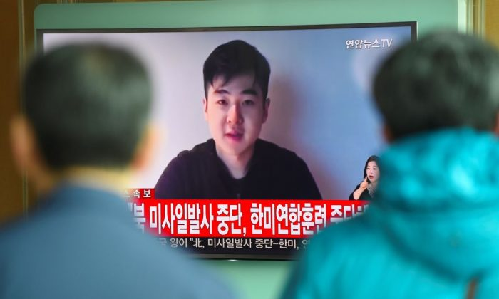 South Koreans watch a television news showing a video footage of a man who claims he is Kim Han-Sol, a nephew of North Korea's leader Kim Jong-Un, at a railway station in Seoul on March 8, 2017. (Jung Yeon-Je/AFP/Getty Images)