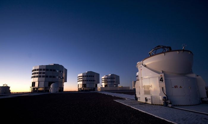 Night view of an auxiliary telescope and three optical telescopes at the European Southern Observatory (ESO) on Sept. 15, 2008, in Paranal, some 715 miles north of Santiago, Chile. (Martin Bernetti/AFP/Getty Images)