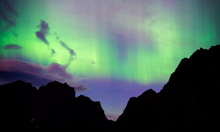 Northern lights (aurora borealis) illuminate the sky over Reinfjorden in Reine, on Lofoten Islands, Arctic Circle, on September 8, 2017./Photographers waiting for the Northern Lights in Siberia on the night of Oct. 26 saw an unexpected sight. (Jonathan Nackstrand/AFP/Getty Images)