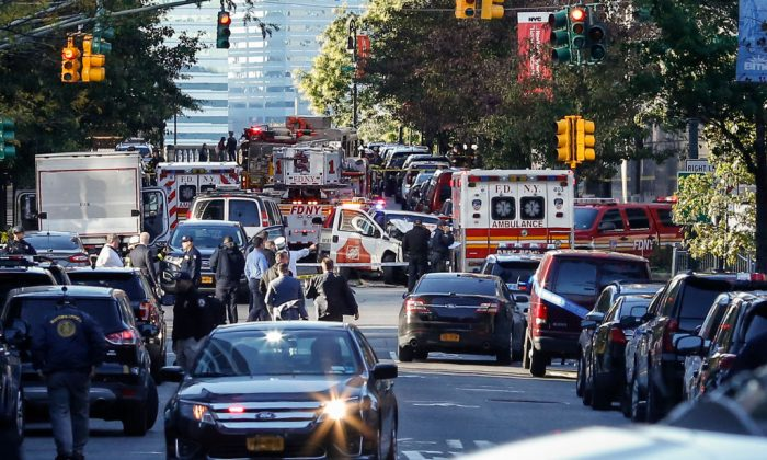 Emergency personal respond after reports of multiple people hit by a truck after it plowed through a bike path in lower Manhattan in New York City on Oct. 31, 2017. According to reports up to eight people have been killed. (Kena Betancur/Getty Images)