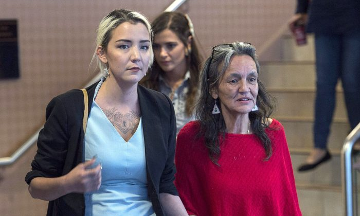 Miriam Saunders (R), mother of Loretta Saunders, and her daughter Delilah Saunders leave the National Inquiry into Missing and Murdered Indigenous Women and Girls, in Membertou, N.S., on Oct. 30, 2017. Loretta Saunders, an Inuk woman, was murdered in Halifax in February 2014. (The Canadian Press/Andrew Vaughan)