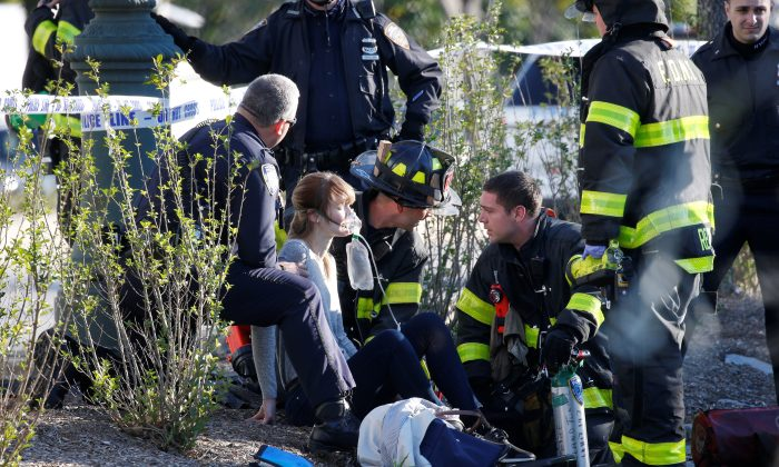 A woman is aided by first responders after sustaining injury on a bike path in lower Manhattan in New York on Oct. 31, 2017.  (REUTERS/Brendan McDermid)