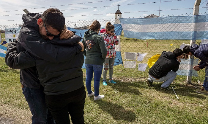 Relatives of crew member Damian Tagliapietra express their grief outside Argentina's Navy base in Mar del Plata, on the Atlantic coast south of Buenos Aires, on Nov. 24, 2017 the day Argentina's navy confirmed an unusual noise heard in the Atlantic near the last known position of a missing submarine appeared to be an explosion, dashing the last hopes of finding the vessel's 44 crew members alive. (Eitan Abramovich/AFP/Getty Images)