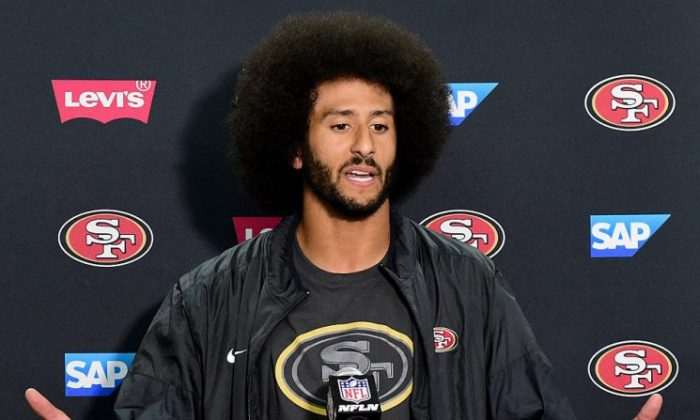 Colin Kaepernick, former #7 of the San Francisco 49ers speaks to media in San Diego, California, on Sept. 1, 2016. (Harry How/Getty Images)