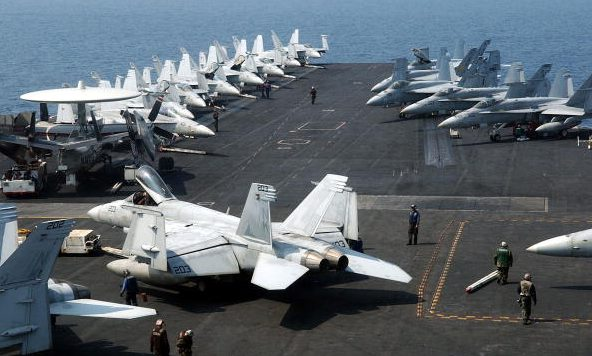 F/A-18C Hornets and F/A-18E/F Super Hornets are lined up on the flight deck of the nuclear-powered aircraft carrier USS Ronald Reagan. (Song Kyung-Suk-Pool/Getty Images)