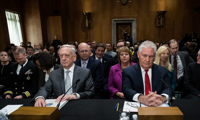 (L to R) U.S. Defense Secretary Gen. Jim Mattis and Secretary of State Rex Tillerson take their seats as they arrive for a Senate Foreign Relations Committee hearing concerning the authorization for use of military force, in Washington, D.C. on Oct. 30, 2017. As Mattis and Tillerson face questions about the administration's authority to use military force, Congress is still seeking more information about the deadly ambush that killed four U.S. troops in Niger. (Drew Angerer/Getty Images)