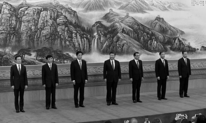 The Communist Party of China's new Politburo Standing Committee, the nation's top decision-making body (L-R) Han Zheng, Wang Huning, Li Zhanshu, Chinese President Xi Jinping, Premier Li Keqiang, Wang Yang, Zhao Leji meet the press at the Great Hall of the People in Beijing on October 25, 2017. (Wang Zhao/AFP/Getty Images)