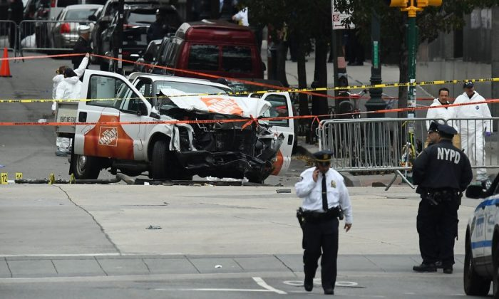Investigators work around the wreckage of a Home Depot pickup truck a day after it was used in a terror attack in New York. (Jewel Samad/AFP/Getty Images)