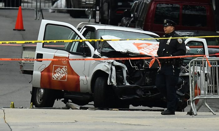A police officer walks past the wreckage of a Home Depot pickup truck on November 1, 2017, a day after it was used in a terror attack in New York City. (JEWEL SAMAD/AFP/Getty Images)