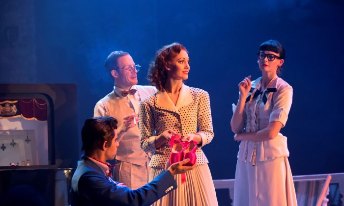 "Ashley Shaw (center) as Victoria Page, surrounded by the company, in ""The Red Shoes."" (Johan Persson)"