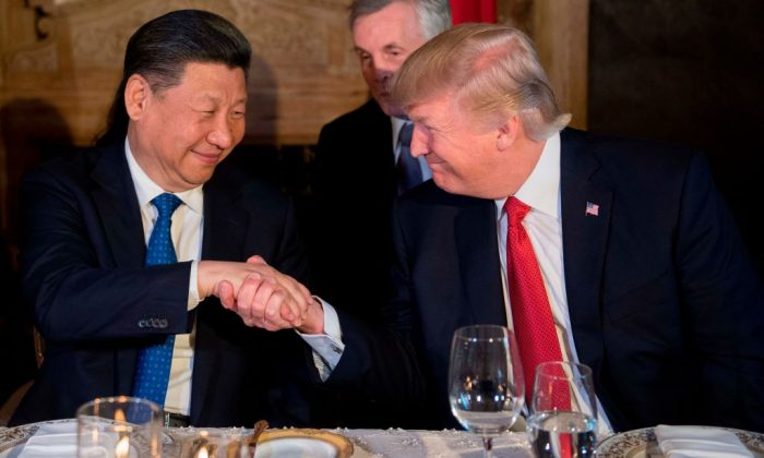 US President Donald Trump (R) and Chinese President Xi Jinping (L) shake hands during dinner at the Mar-a-Lago estate in West Palm Beach, Florida, on April 6, 2017. (Jim Watson/AFP/Getty Images)