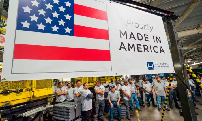 Workers at the Hollywood Bed Frame Company attend an event to mark the company's upcoming expansion, which will double the manufacturer's workforce, adding 100 new local jobs, at the company's factory in Commerce, Calif., on April 14, 2017. (ROBYN BECK/AFP/Getty Images)