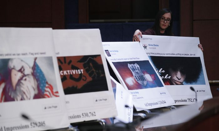 A congressional staff member displays a print out of social media posts during a hearing before the House Select Intelligence Committee on Capitol Hill in Washington, D.C. on Nov. 1, 2017. The committee held a hearing on 'Russia Investigative Task Force: Social Media Companies.' (Alex Wong/Getty Images)