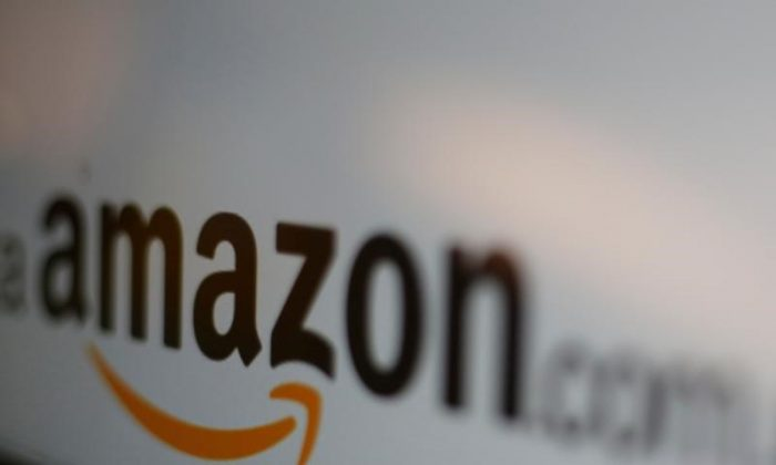The logo of the web service Amazon is pictured in this June 8, 2017 illustration photo. (Reuters/Carlos Jasso/Illustration)