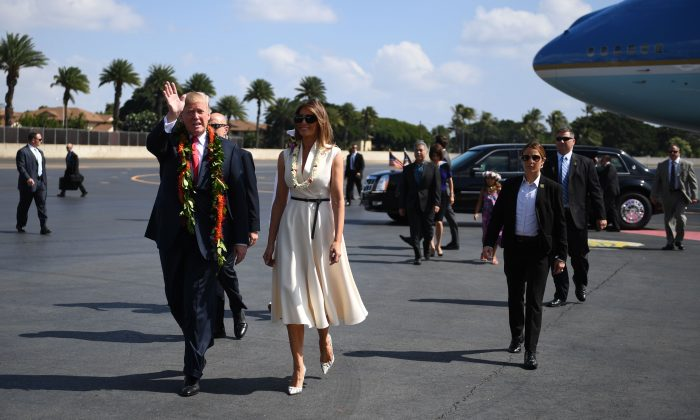 President Donald Trump and First Lady Melania Trump arrive at Joint Base Pearl Harbor-Hickam in Hawaii on Nov. 3, 2017. (JIM WATSON/AFP/Getty Images)
