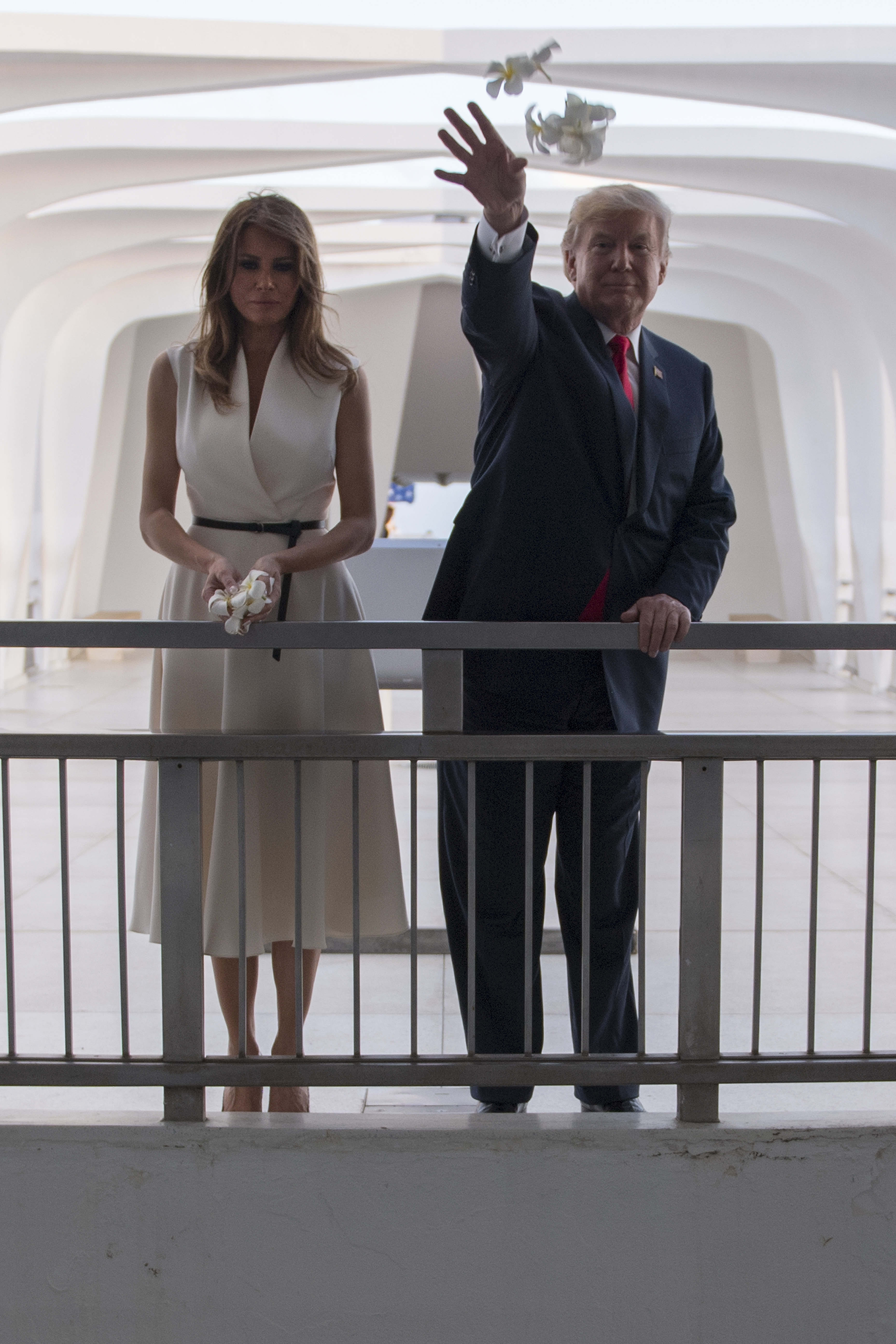 58e07636576cd President Donald Trump and First Lady Melania Trump throw flowers during  their visit to the USS Arizona Memorial on Nov. 3