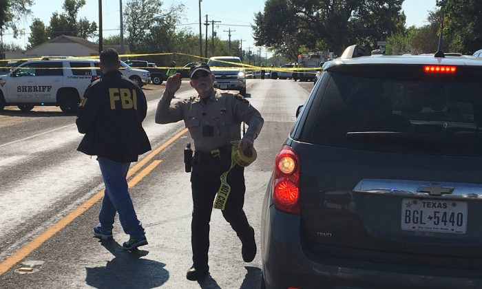 FBI officials arrive at the site of a mass shooting in Sutherland Springs, Texas, on Nov. 5, 2017, in this picture obtained via social media. (MAX MASSEY/ KSAT 12/via REUTERS)