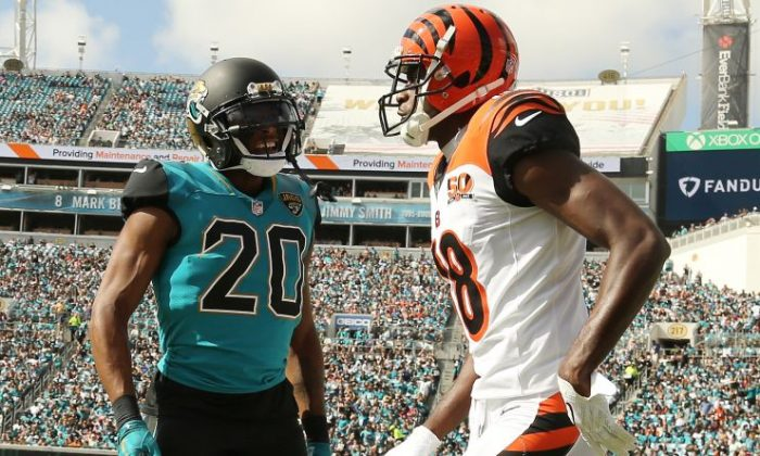 A.J. Green #18 of the Cincinnati Bengals and Jalen Ramsey #20 of the Jacksonville Jaguars discuss a play in the first half of their game at EverBank Field on Nov. 5, 2017, in Jacksonville, Fla. (Logan Bowles/Getty Images)