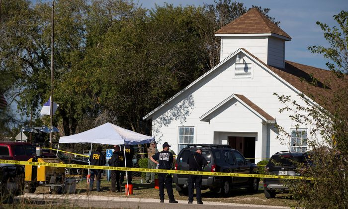 Law enforcement officials investigate a mass shooting at the First Baptist Church in Sutherland Springs, Texas on Nov. 5, 2017. (Nick Wagner/AMERICAN-STATESMAN via REUTERS)