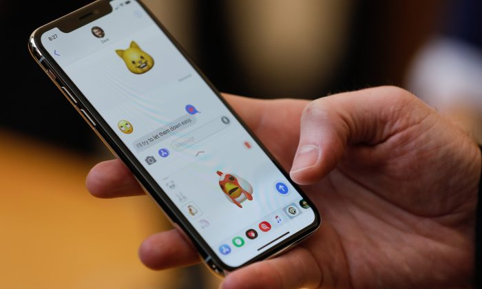 An Apple employee demonstrates the Animoji feature on the new iPhone X at the Apple Store Union Square on November 3, 2017, in San Francisco, California. (Elijah Nouvelage/AFP/Getty Images)