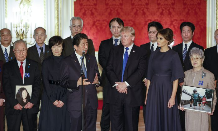 President Donald Trump and First Lady Melania Trump meet with an abductee and families of others still abducted by North Korea, in Tokyo on Nov. 6, 2017. (KIMIMASA MAYAMA/AFP/Getty Images)