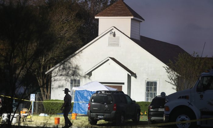 Law enforcement officials continue their investigation at First Baptist Church of Sutherland Springs as the sun begins to rise on Nov. 6, 2017 in Sutherland Springs, Texas. (Scott Olson/Getty Images)