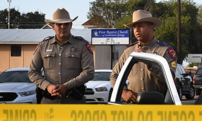 State troopers guard the entrance to the First Baptist Church (back) after a mass shooting that killed 26 people in Sutherland Springs, Texas on November 6, 2017. (Mark Ralston/AFP/Getty Images)