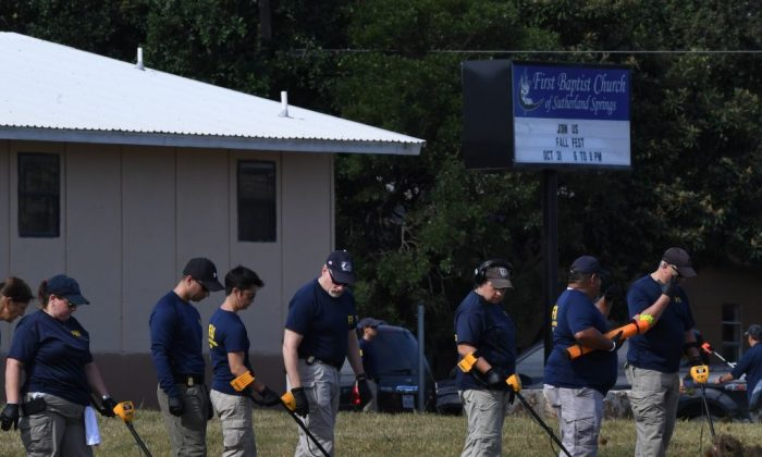 FBI agents search for clues at the entrance to the First Baptist Church, after a mass shooting that killed 26 people in Sutherland Springs, Texas on Nov. 6, 2017. (Mark Ralston/AFP/Getty Images)