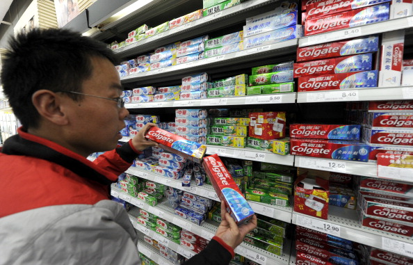 A shopper picks toothpaste at a supermarket in Beijing on March 30, 2011. (Liu Jin/AFP/Getty Images)