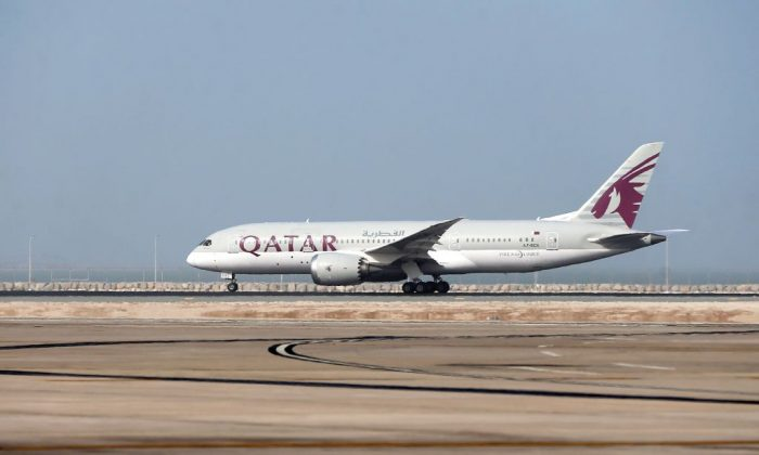 A Qatar Airways plane takes-off from the Hamad International Airport in Doha on July 20, 2017. (Stringer/AFP/Getty Images)